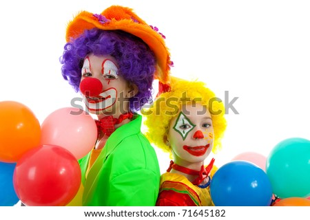 portrait of two children dressed as colorful funny clowns with balloons over white background