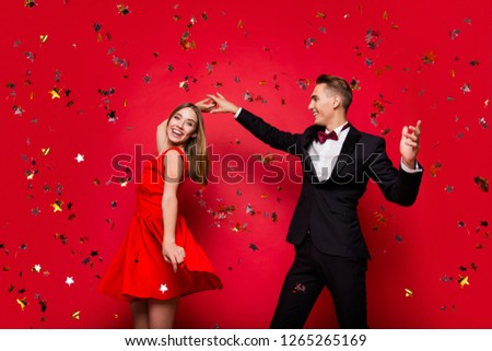 Portrait of two cool slim graceful classy elegant chic attractive cheerful positive people friends rejoicing flying decorative elements having fun isolated over bright vivid shine red background #1265265169