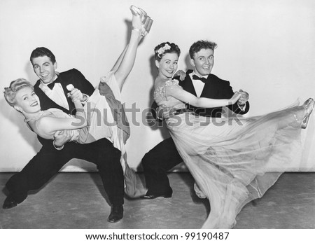 portrait of two couples dancing