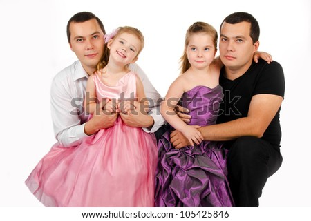 Portrait of two cute little girls with their twins fathers isolated