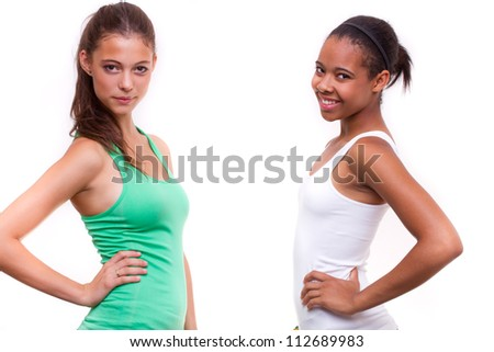 portrait of two different nationalities teenage girls friends - isolated on white background