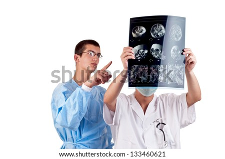 portrait of two doctors examining a head tomography
