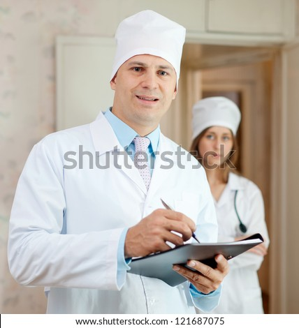 Portrait of two doctors in clinic interior