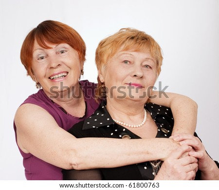 Portrait of two elderly sisters - stock photo
