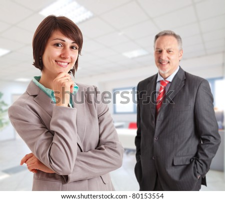 Portrait of two executives in an office environment.