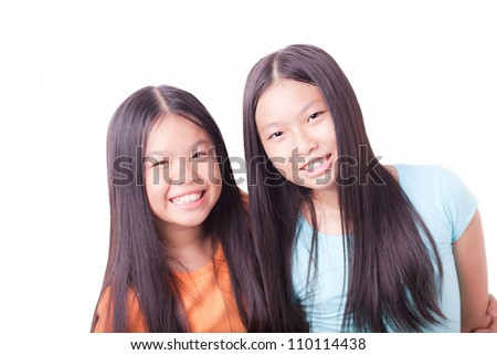 Portrait of two friends smiling at camera