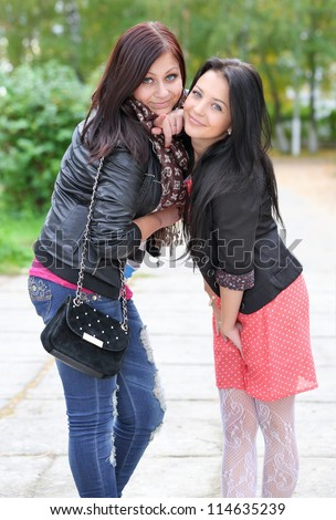 Portrait of two girls  enjoying at the park - Outdoor