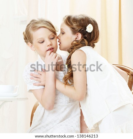 portrait of two gossiping girls