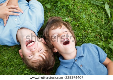 Portrait of two happy brothers in summer park