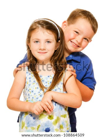 Portrait of two happy children isolated on white