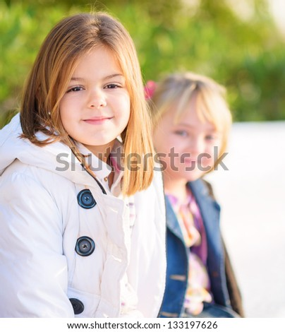 Portrait Of Two Happy Girls, Outdoors