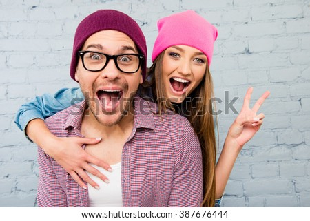 Shutterstock Portrait of two happy  lovers in caps huging and screaming