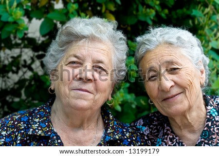 Portrait of Two Happy Senior Sisters