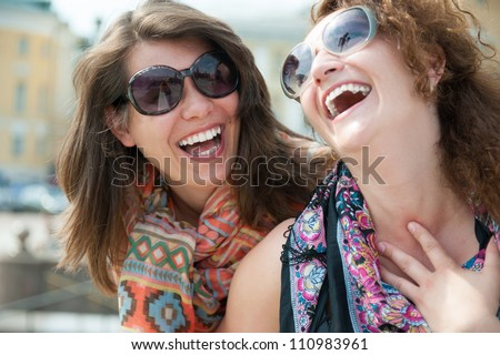 Portrait of two happy young beautiful women