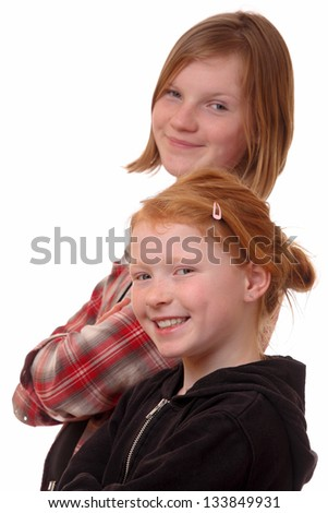 Portrait of two happy young girls on white background