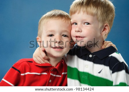 portrait of two little boys with a smile on the face