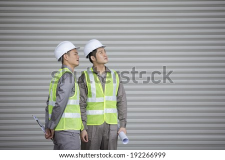 Portrait of two male Chinese industrial engineer\'s at work