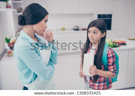 Portrait of two nice cute lovely sweet attractive confused puzzled unsure people mommy mom negative marks in light white kitchen interior #1308335425