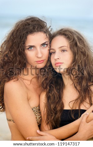 Portrait of two pretty girls on the beach