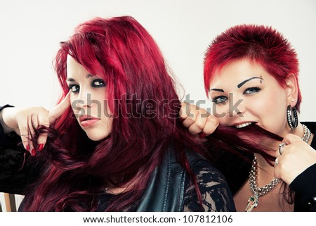 Portrait of two red-haired women - stock photo