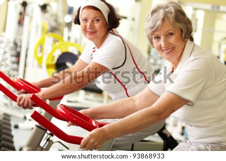 Portrait of two senior women in gym