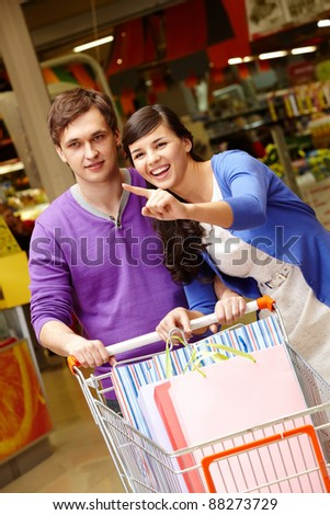 Portrait of two shopaholics during shopping in the mall