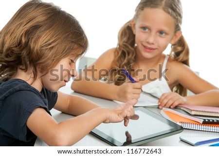 Portrait of two small kids doing homework on digital tablet.Isolated