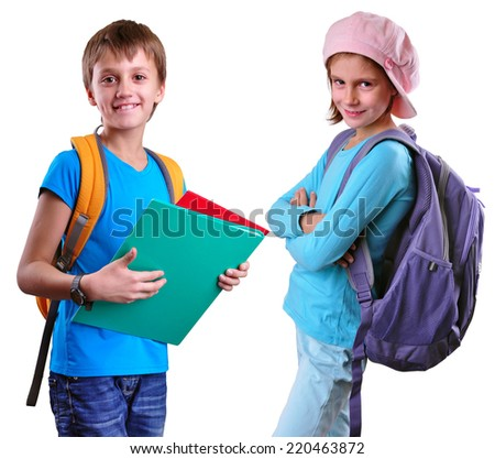 Portrait of two smiling pupils of grade school with backpacks and books posing. Isolated over white background. Education childhood concept