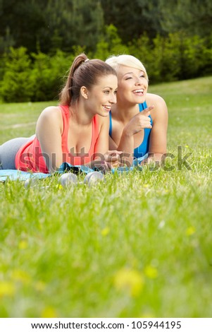 Portrait of two sport woman having fun in summer environment