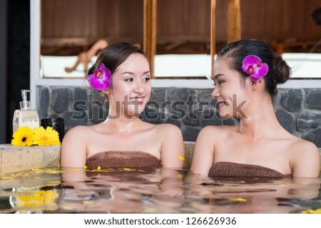 Portrait of two women having spa procedures