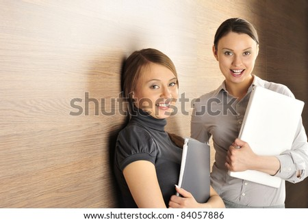 Portrait of two women in the hall. Office background.