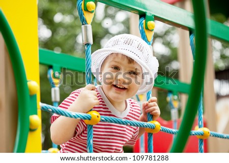 Portrait of two-year child at playground area in summer
