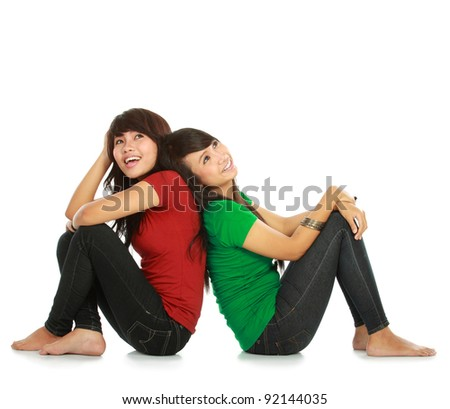 portrait of two young asian female looking up thinking something on white background
