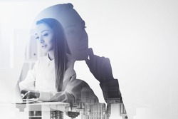 Portrait of two young European businesswomen over blurry city background. Concept of leadership. Toned image double exposure