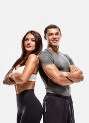 Portrait of two young fit sporty people with crossed hands