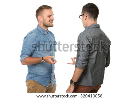 portrait of two young  man talking to each other, isolated over white background #320410058