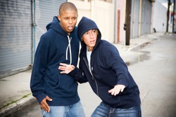 Portrait of two young street gang members looking suspicious