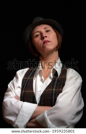 Portrait of ugle middle-aged woman with hat. Model posing in men's style in the Studio Stock foto ©