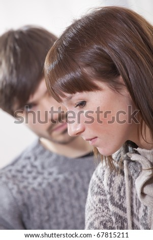 portrait of unhappy and sad couple at home