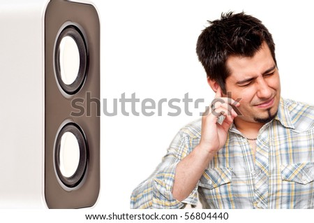 portrait of unhappy man plugging his ear from noise