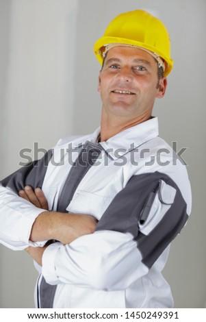 portrait of uniformed tradesman wearing hardhat