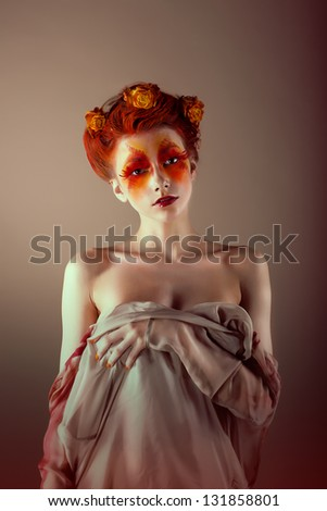 Portrait of Unusual Redhead Woman with False Red Eyelashes. Fantasy