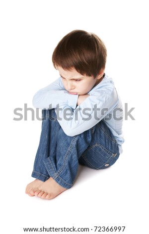 Portrait of upset little boy isolated on white background