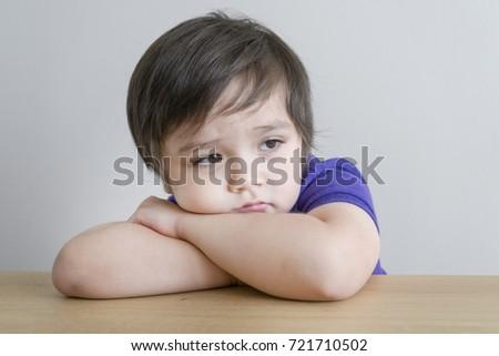 Portrait of upset little boy, Kid sad face, Unhappy child looking out, Emotion portrait of toddler, Spoiled children concept