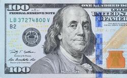 Portrait of US president Benjamin Franklin on 100 dollars banknote closeup macro fragment. United states hundred dollars money bill
