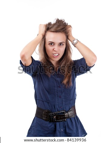 Portrait of very frustrated and angry mad woman pulling her hair against white background