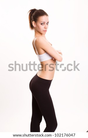 Portrait of very slender athletic young brunette woman.