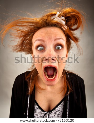 Portrait of very surprised bizarre screaming housewife