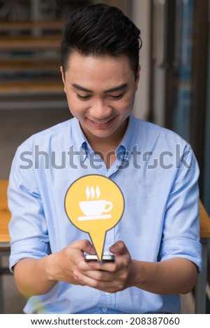 Portrait of Vietnamese young man texting