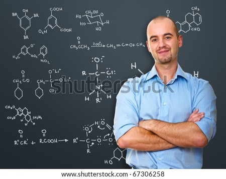 portrait of white teacher infront of blackboard